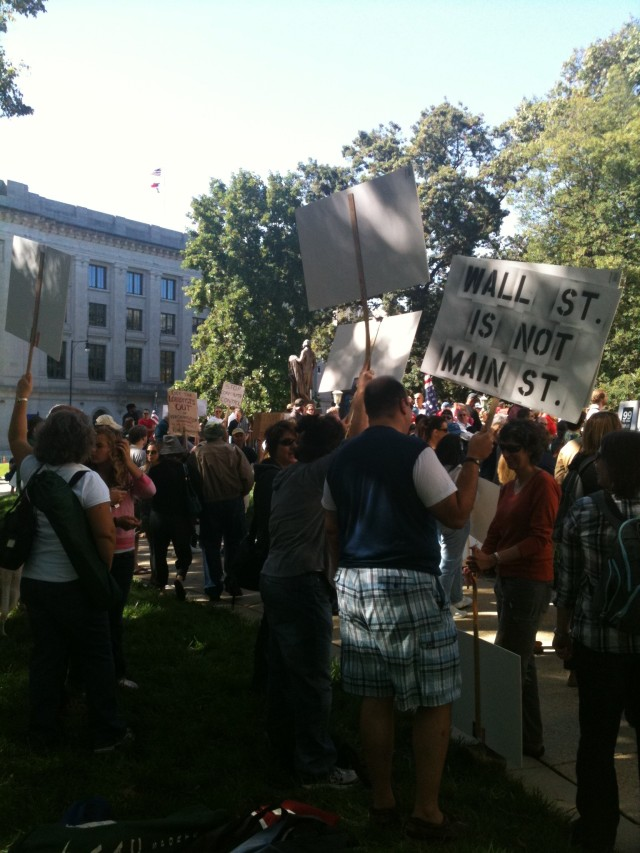 Occupy Raleigh - meditating on the signs - hey yoga man