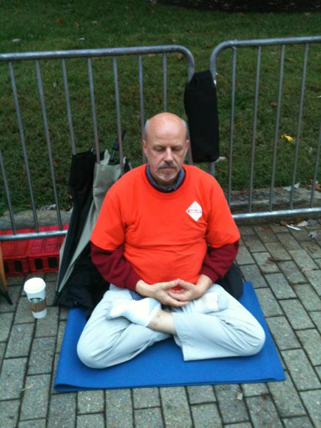 meditating at Occupy Raleigh hey yoga man